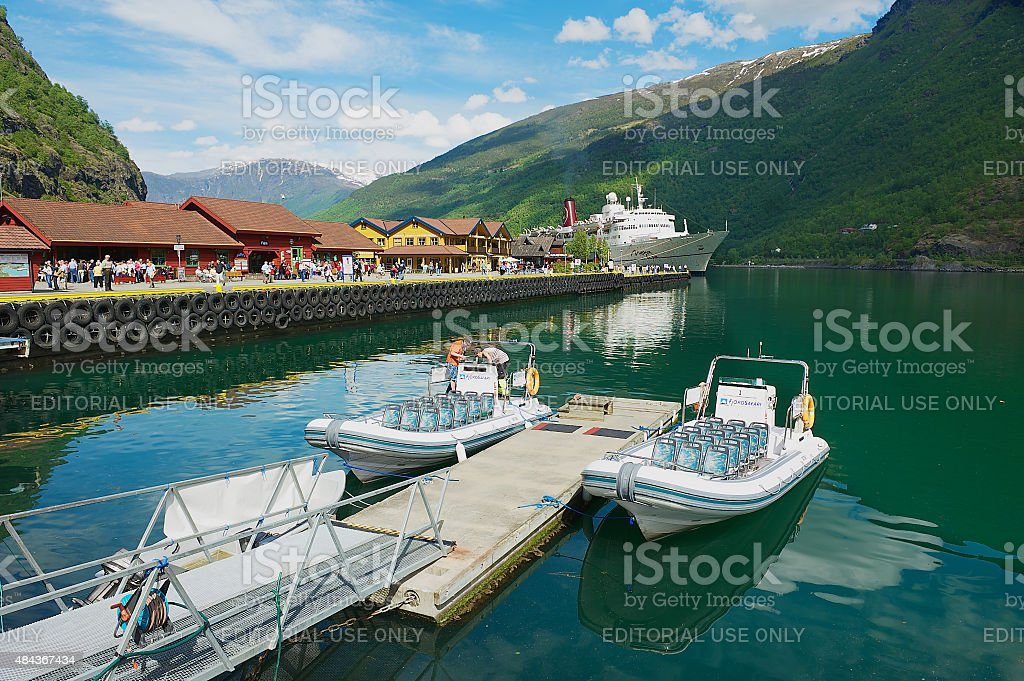 Boats tied at the railway station pier in Flam, Norway. stock photo
