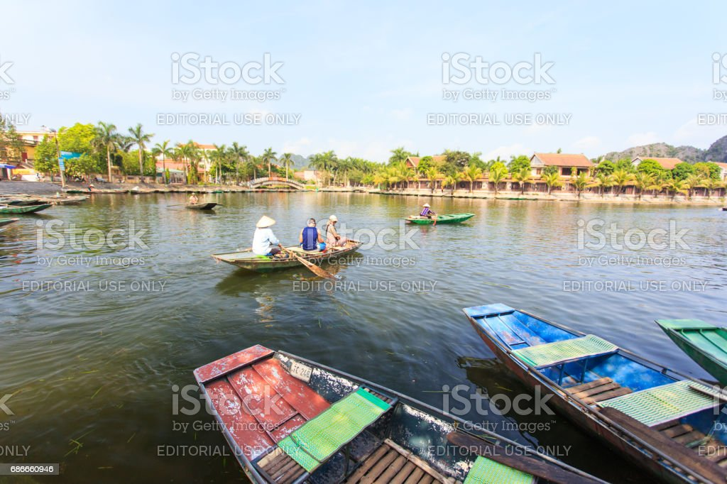 Boats to travelers in Trang An. stock photo
