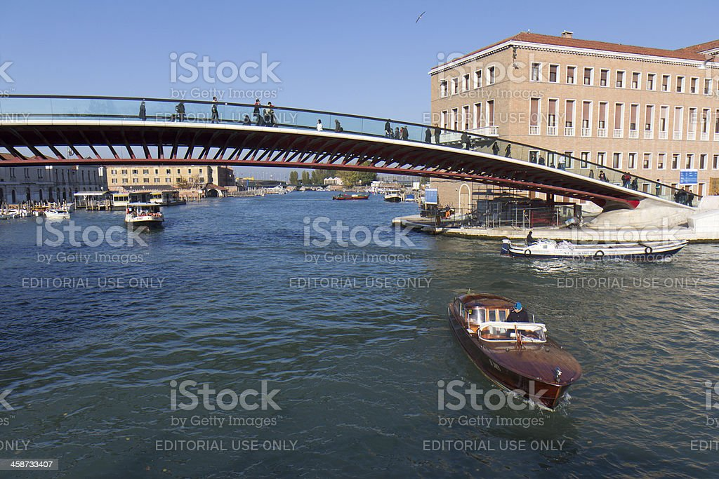Boats under a modern bridge in Venice royalty-free stock photo
