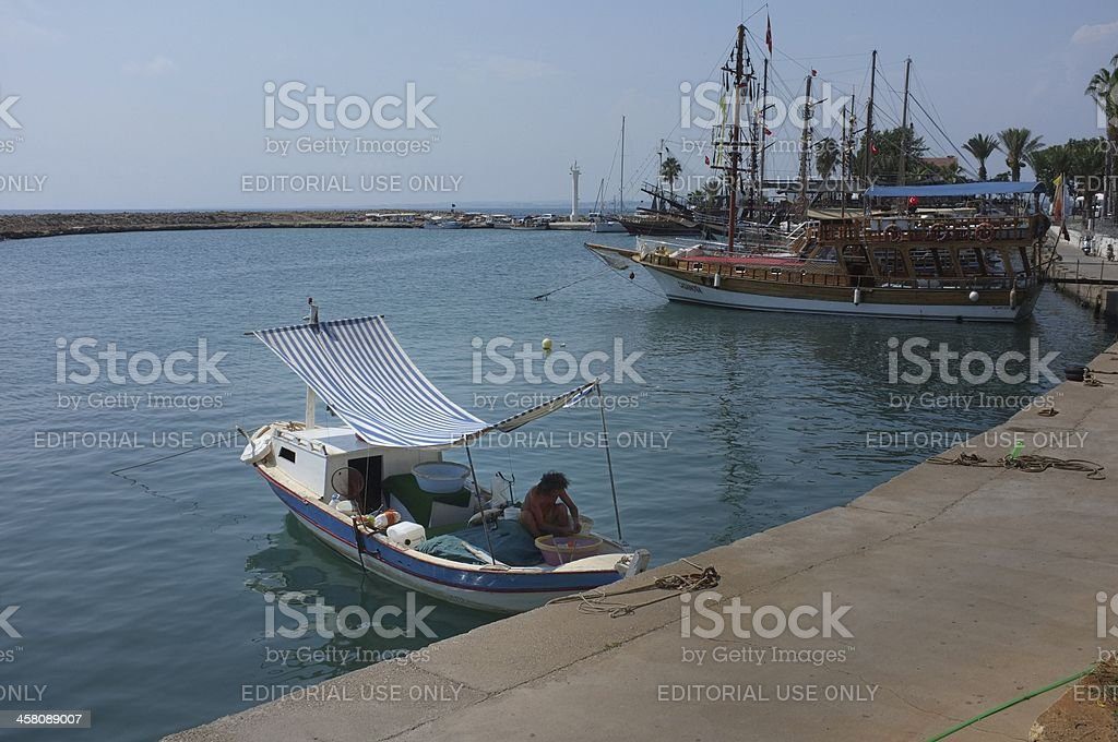 Boats wait for tourists at Side harbor in Turkey royalty-free stock photo