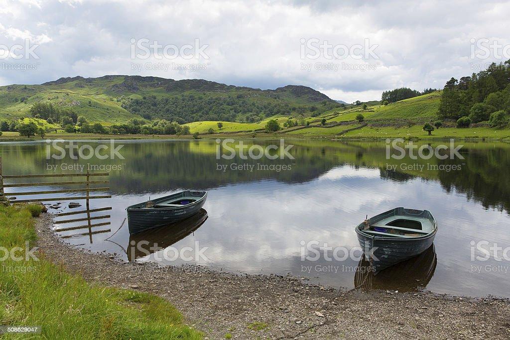 Boats Watendlath Tarn Lake District Cumbria England calm still water stock photo
