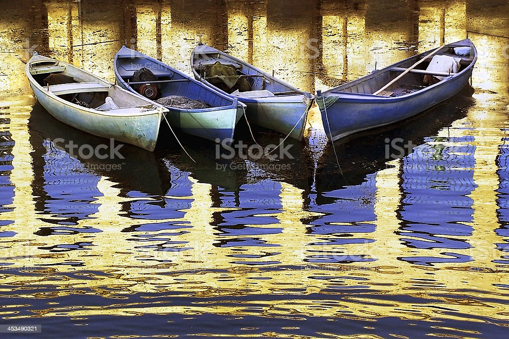 Boats with bridge reflection on water stock photo