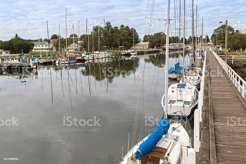 Boats, yachts mooring along Moyne River in Port Fairy, Australia stock photo