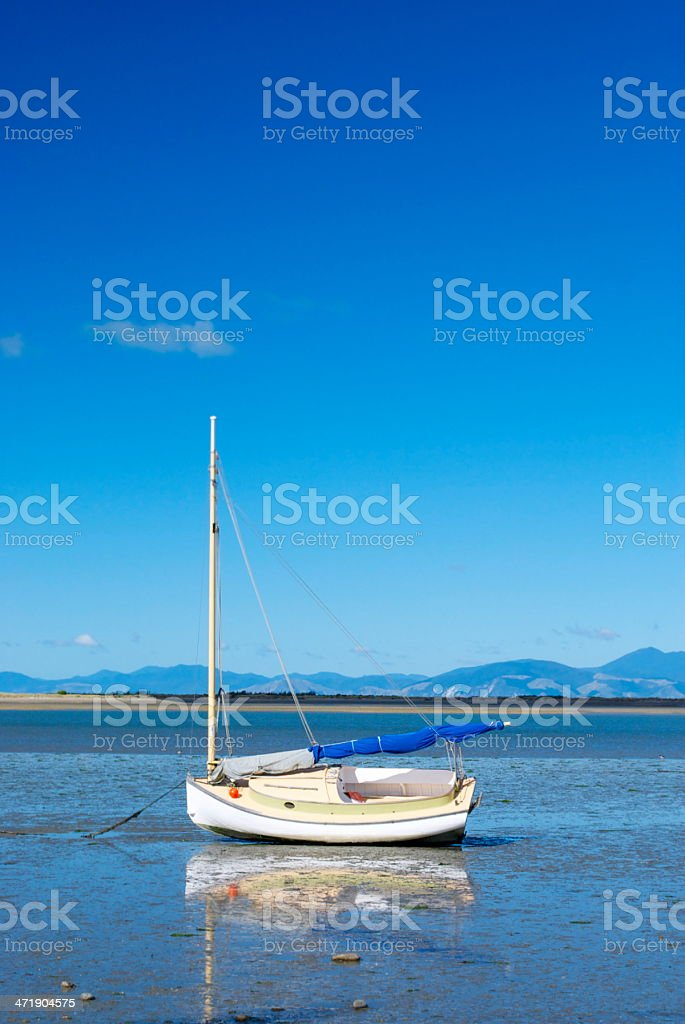 Boatscape and Reflection at lowtide. royalty-free stock photo