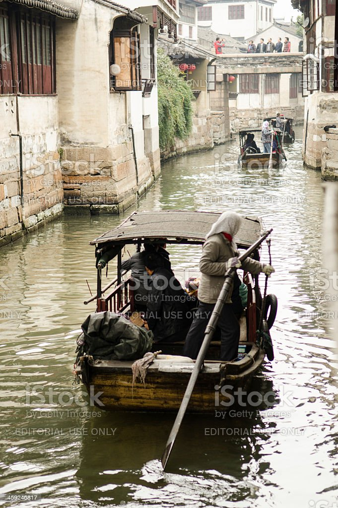 boatwomen driving their traditional wooden boats stock photo