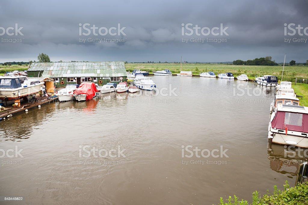 boatyard and boats at moorings river Bure Norfolk Broads England stock photo