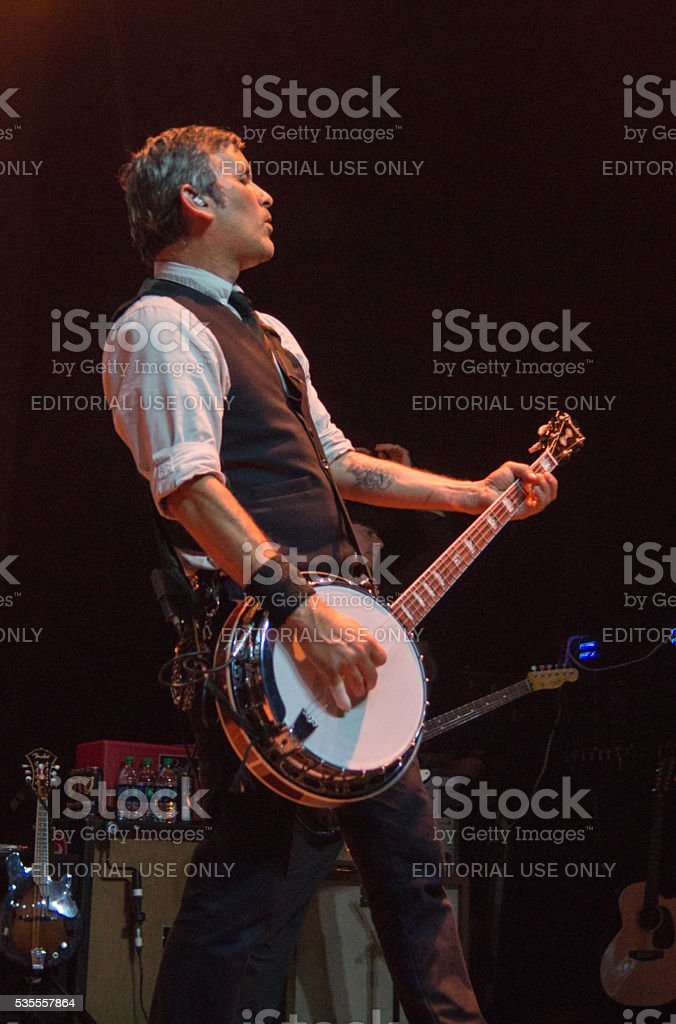 Bob Schmidt plays banjo with band Flogging Molly in Dallas stock photo