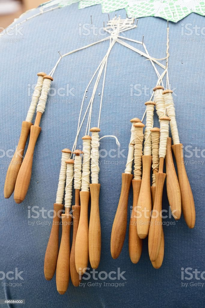 Bobbins for lace making stock photo