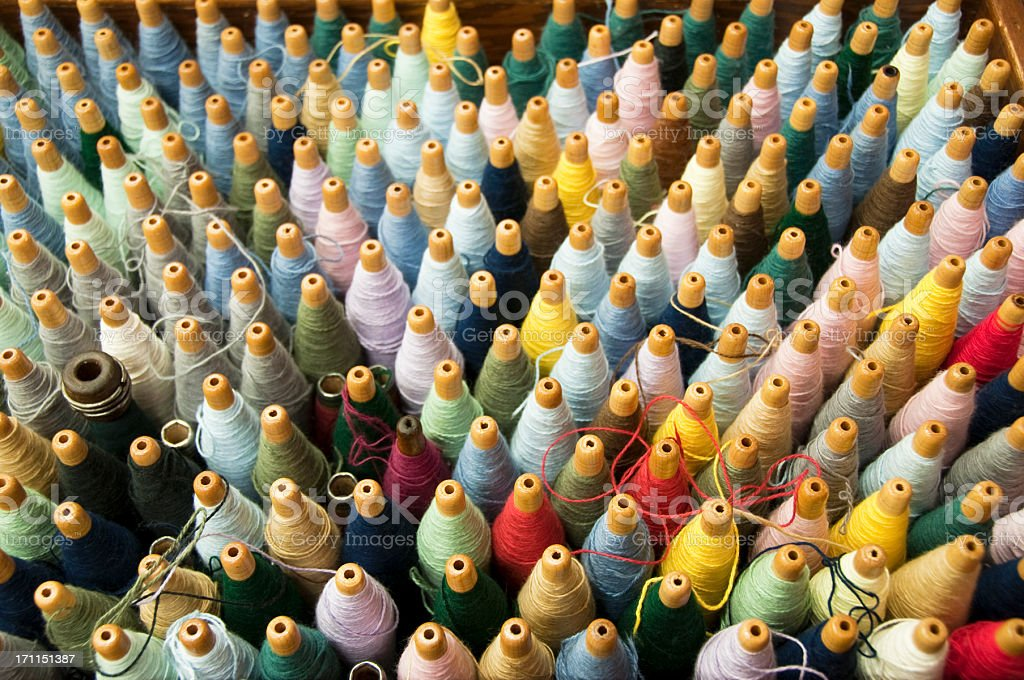 bobbins of wool yarn stock photo
