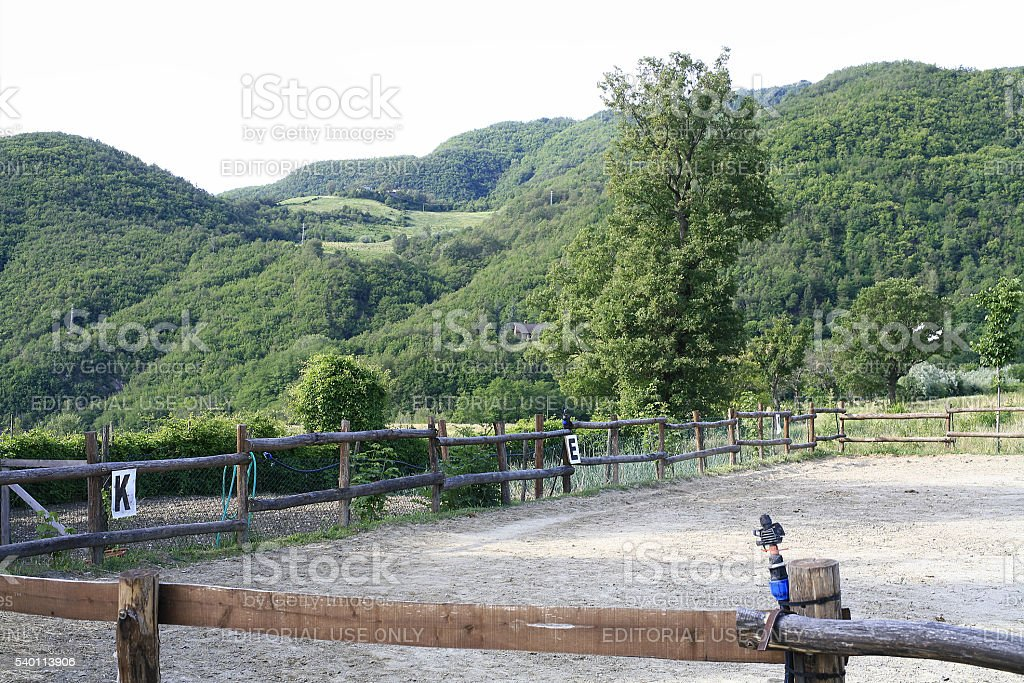 Bobbio (Italy). Horse corral with wooded hills in the background stock photo