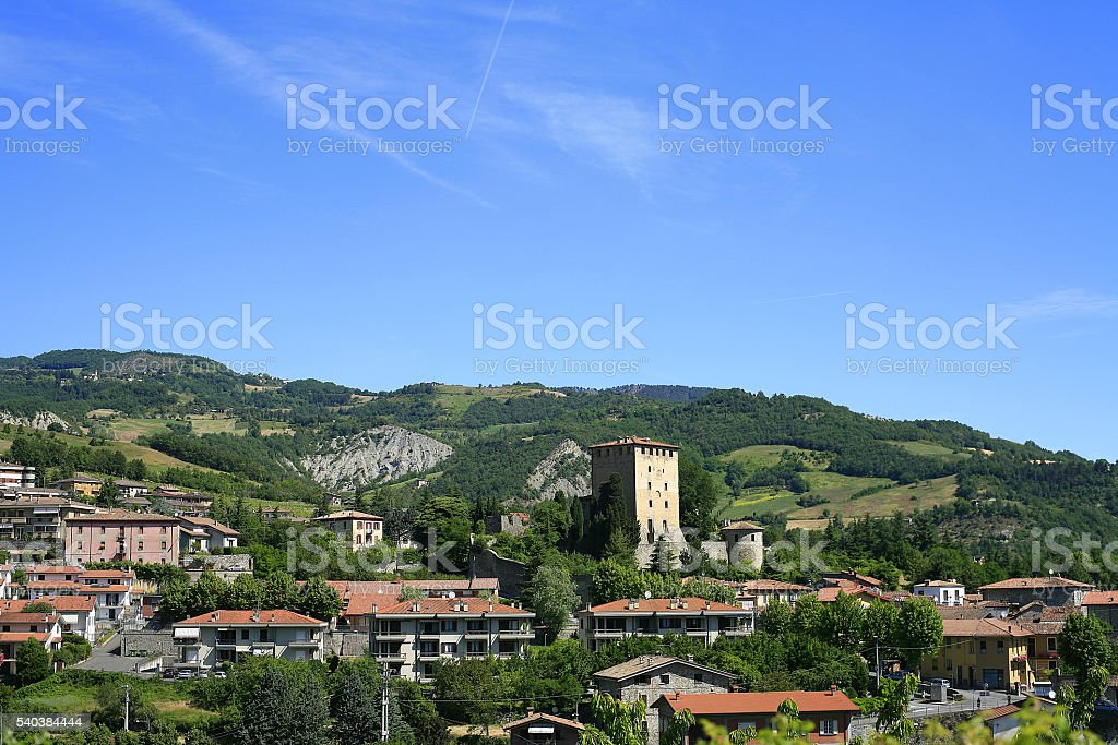 Bobbio (Italy). The town of Bobbio surrounded by wooded hills stock photo