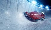 Bobsleigh team at night