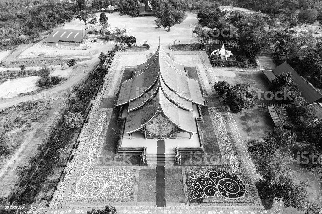 Bodhi tree glow Wat Sirindhornwararam (Phu Prao Temple), Ubon Ratchathani, Thailand. temple aerial view Thailand. stock photo