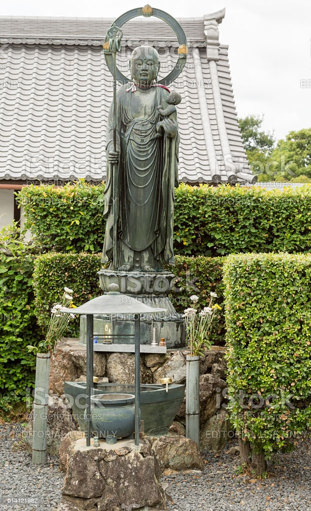 Bodhisattva Kshitigarbha statue at Kurodani Buddhist Temple. stock photo