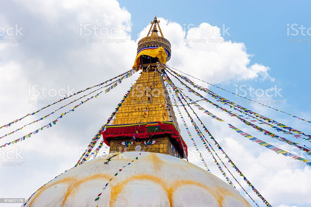 Bodhnath stupa in Kathmand, buddha eyes and prayer flag, 2014 stock photo