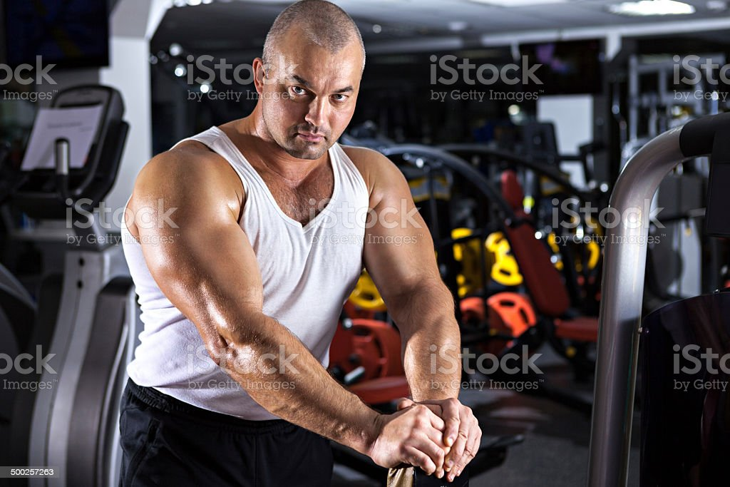 Bodibuilder in the gym stock photo