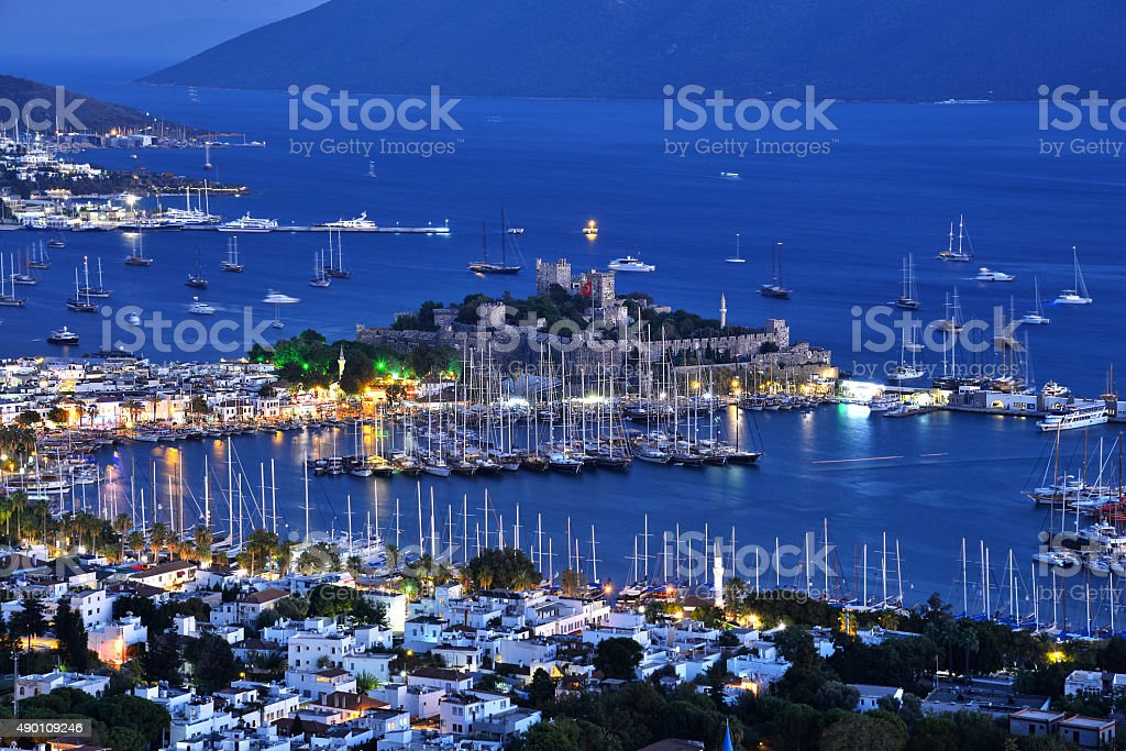 Bodrum harbor and Castle of St. Peter after sunset stock photo