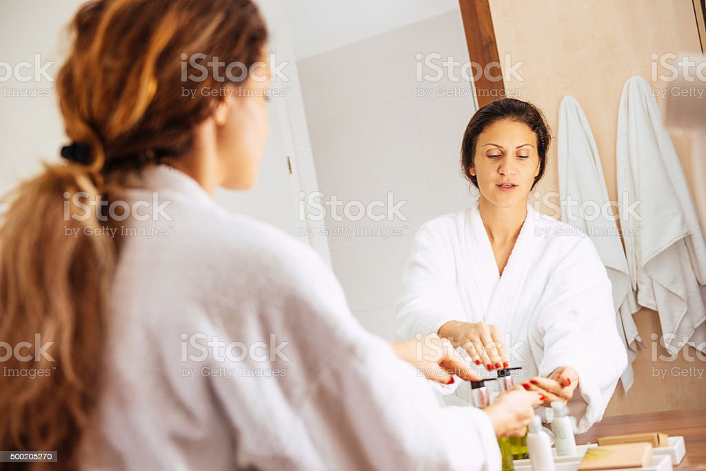 Body and skin care in bathroom - woman using soap stock photo