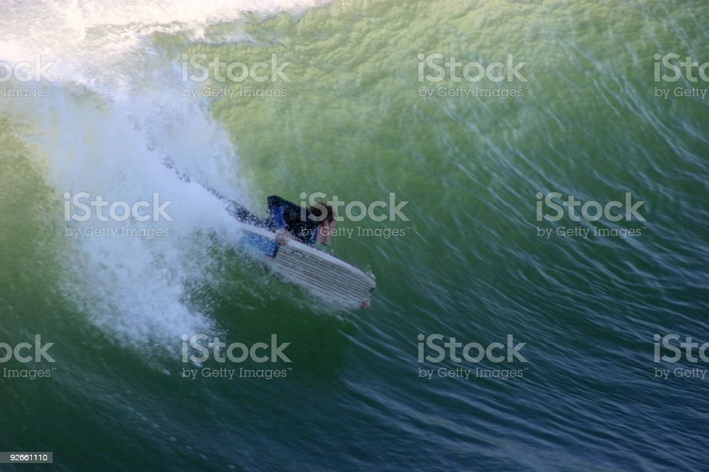 Body boarder on huge wave stock photo