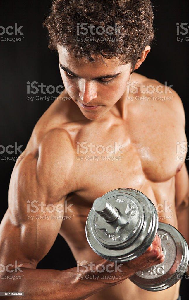 Body builder bicep curl stock photo