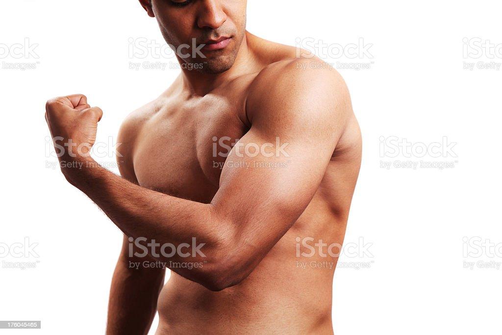 Body builder flexing biceps royalty-free stock photo