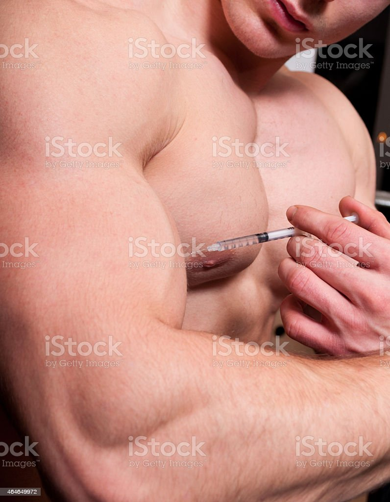 Body builder injecting steroids stock photo