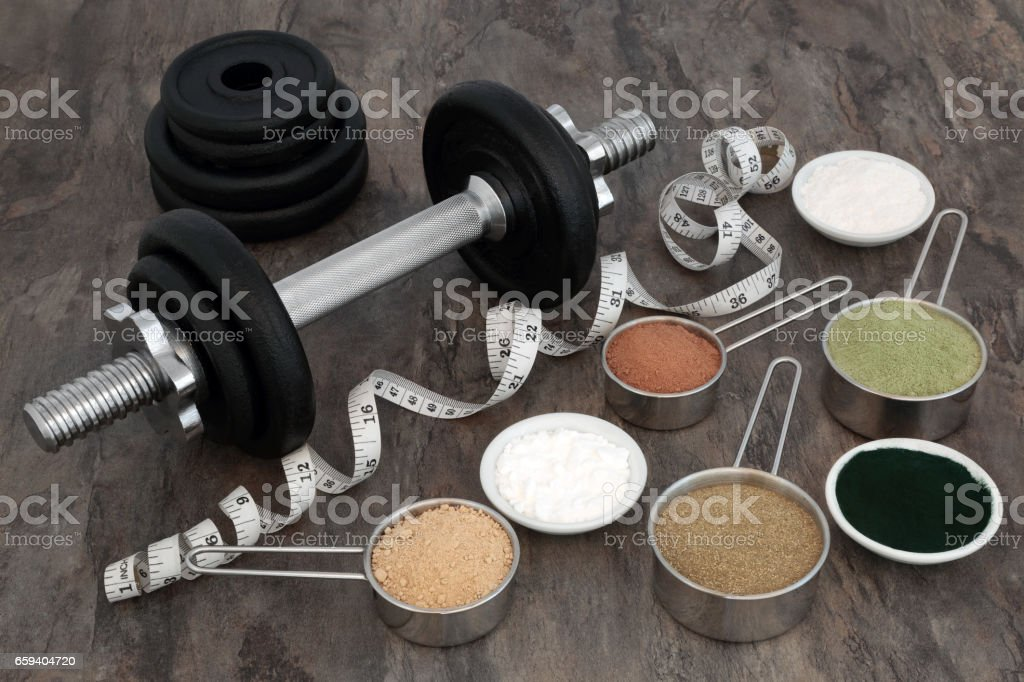 Body Building Equipment and Food Supplements stock photo