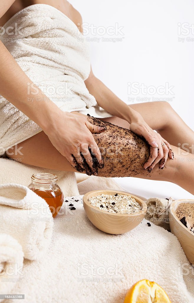 Body care at home. Natural anti cellulite massage with coffee stock photo