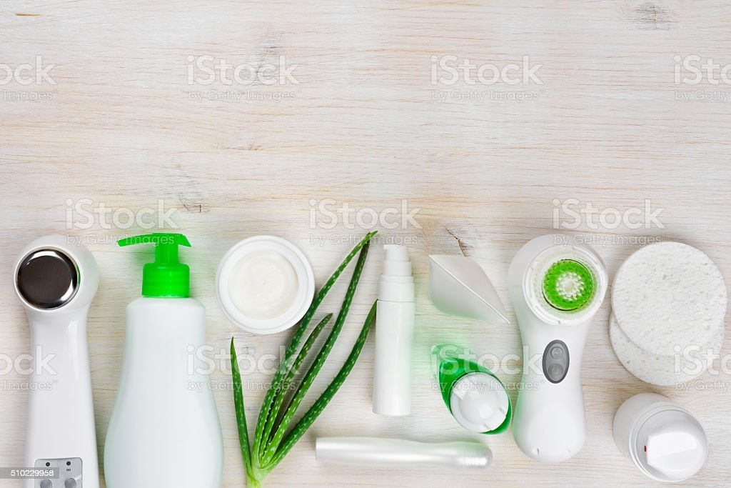 Body care products on wooden background with copyspace at top stock photo