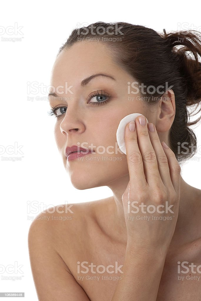 Body care series - Young woman removing make-up royalty-free stock photo