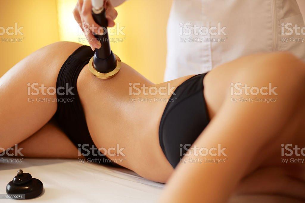 Body Care. Ultrasound Cavitation Body Contouring Treatment. Ant stock photo