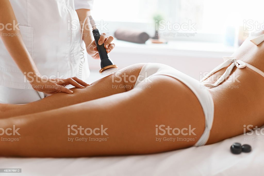 Body Care. Ultrasound Cavitation Body Contouring Treatment. Anti-Cellulite stock photo