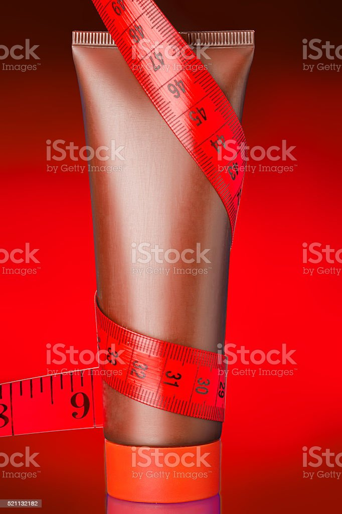 Body cream on a tube  with centimeter. stock photo