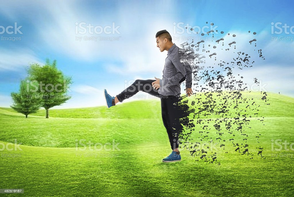 body explosion after kicking in a park stock photo