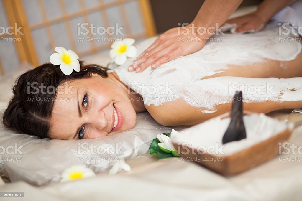 Body massage - mud treatment stock photo