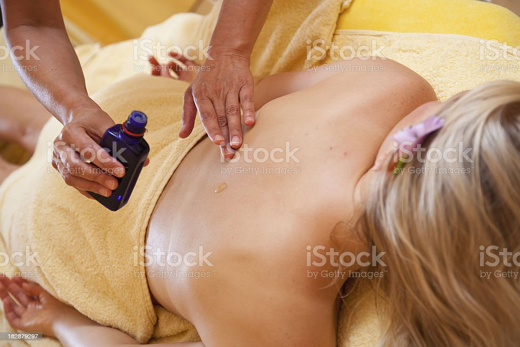 body massage with oil royalty-free stock photo