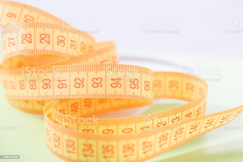 Body measuring tape is on the surface stock photo