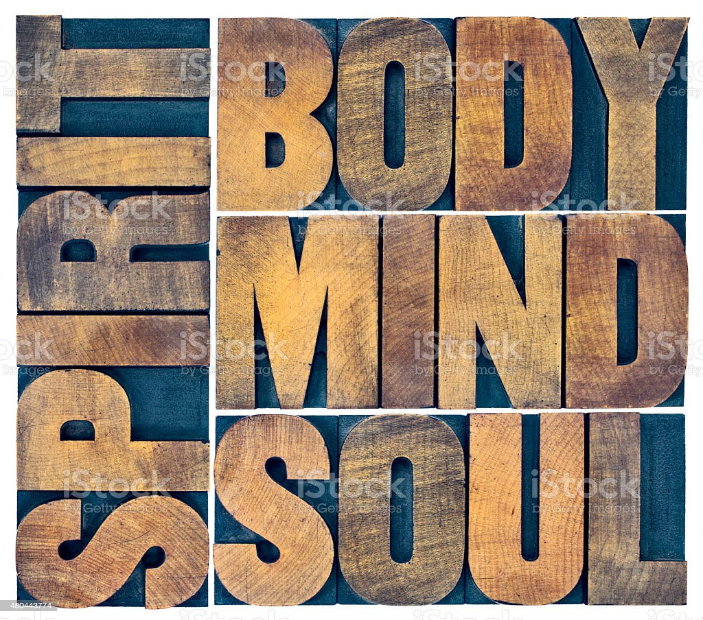 body, mind, soul and spirit in wood type stock photo