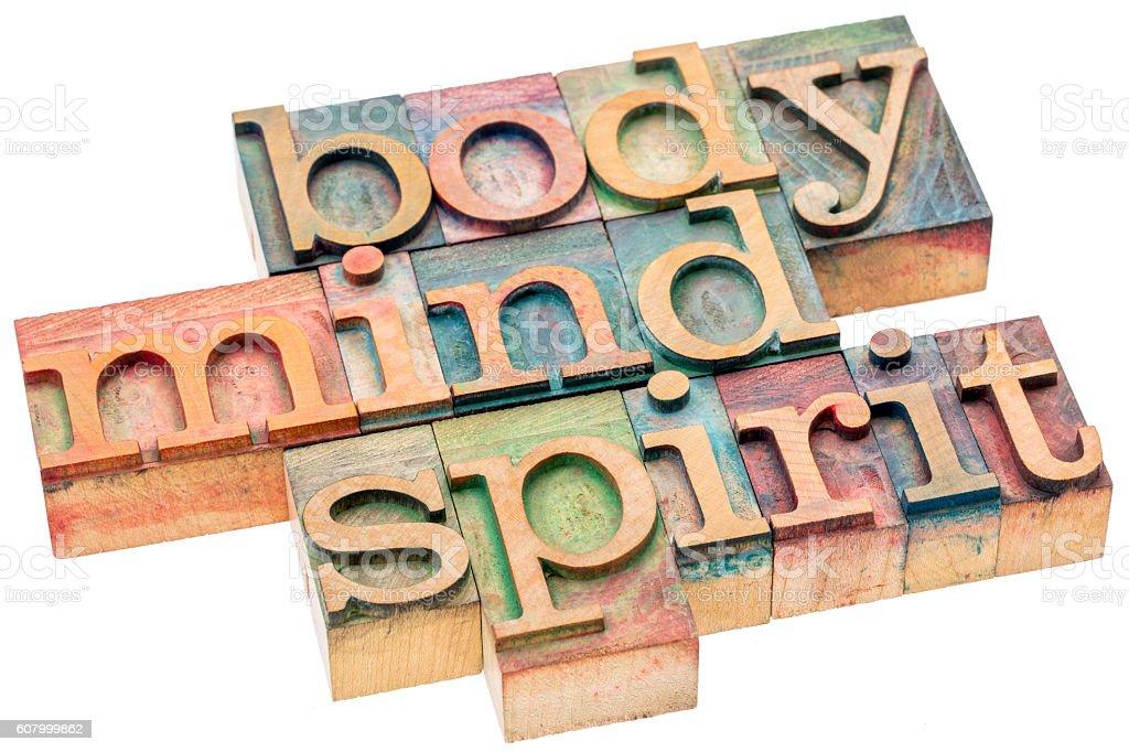 body, mind, spirit concept in wood type stock photo