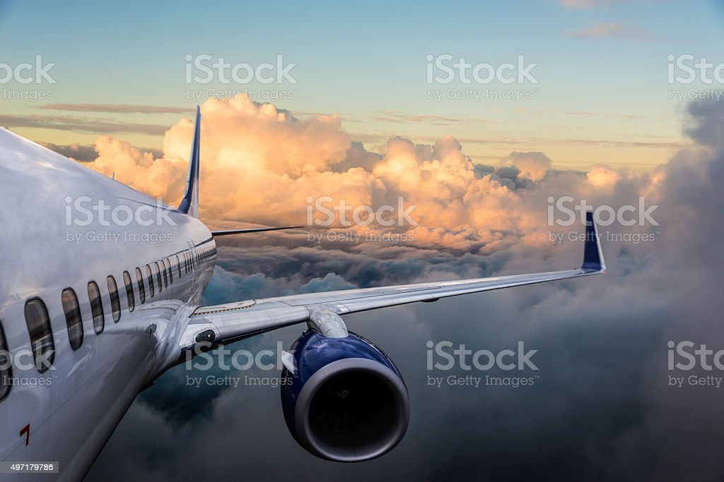Body of an Airplane Flying Above Cloud stock photo