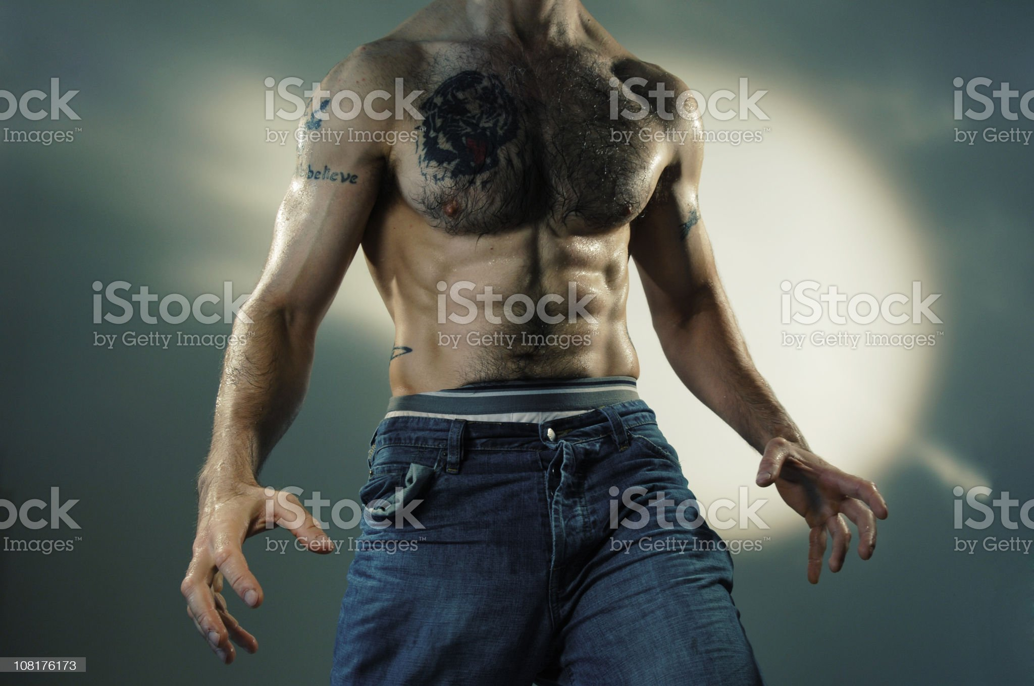 Body of Shirtless and Tattooed Man royalty-free stock photo