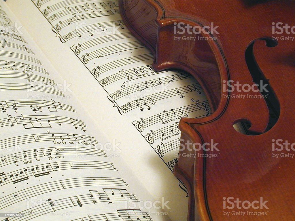 Body of violin resting on open Messiah score royalty-free stock photo