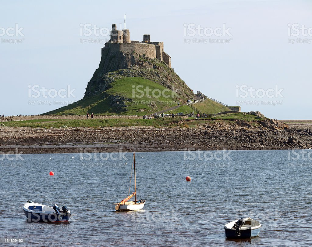 Body of water in front of Lindisfarne Castle Holy Isle. stock photo