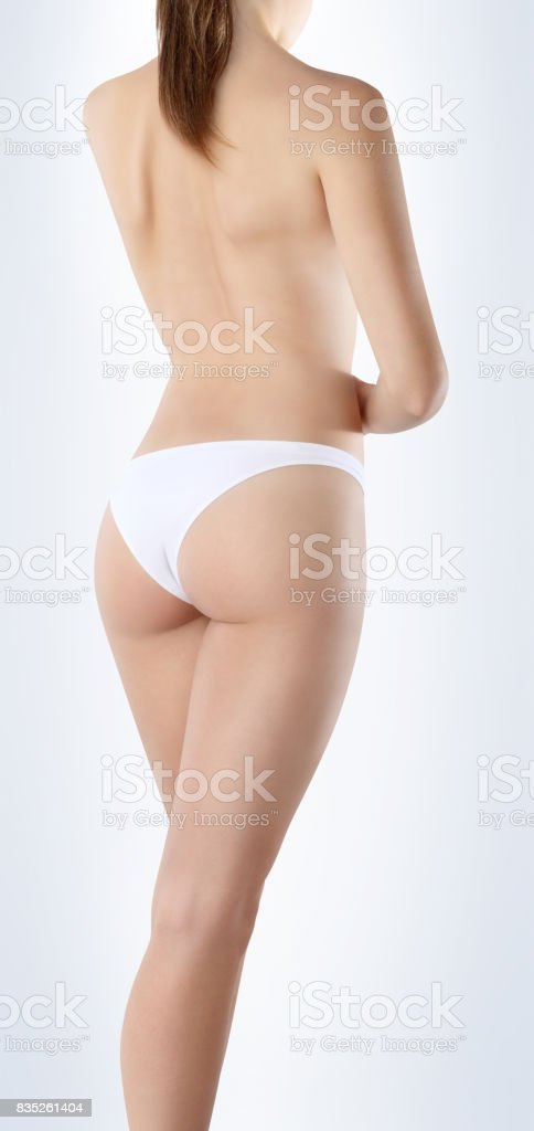 body of woman seen from behind on white background, body care concept