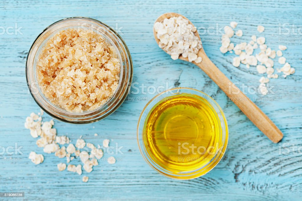 Body scrub of oatmeal, sugar, honey and oil, top view stock photo