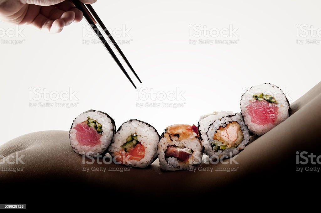 Body sushi - rolls on a naked woman stock photo