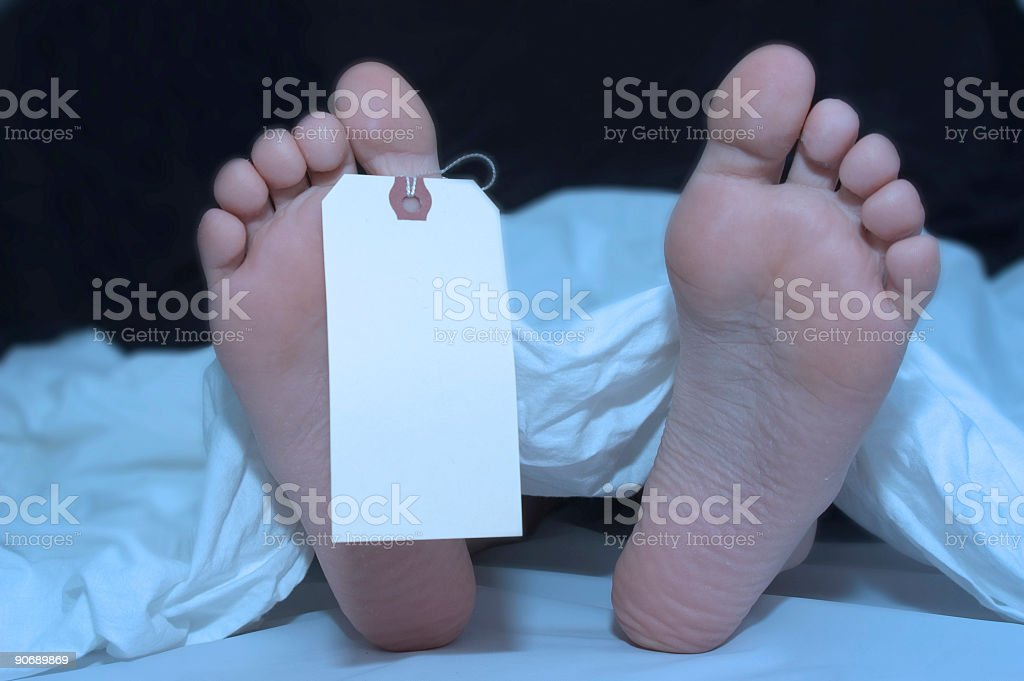 Body with toe tag: colour stock photo