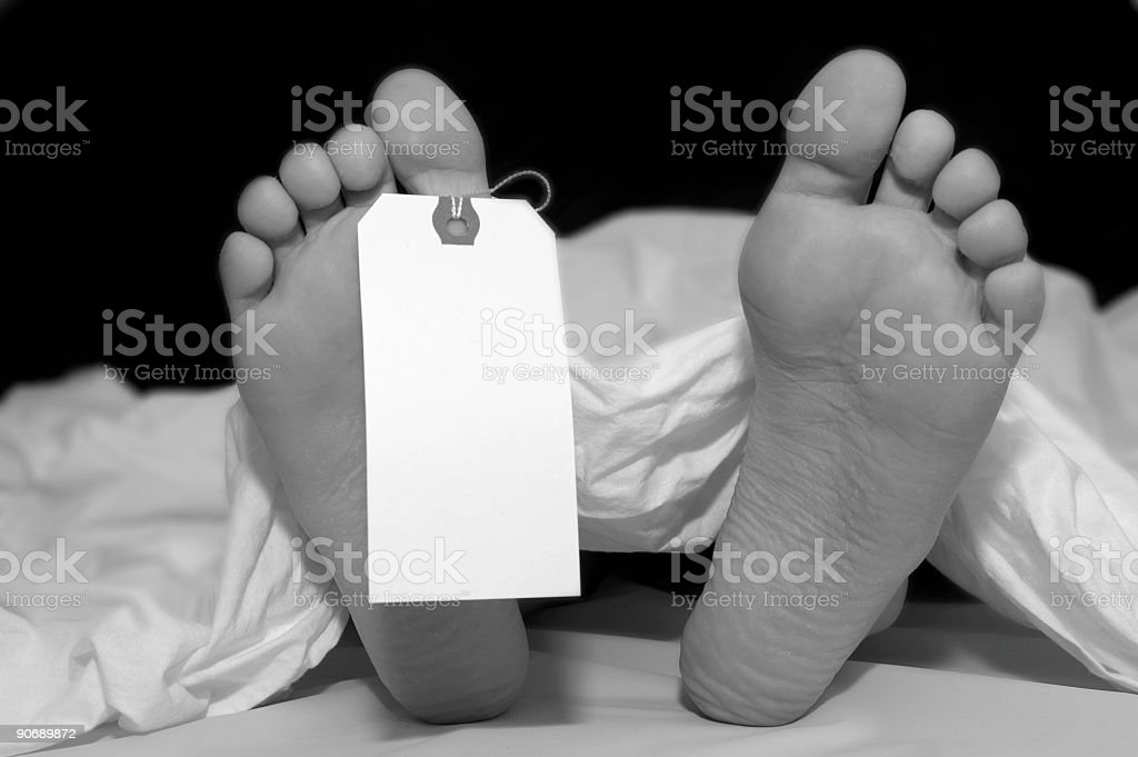 Body with toe tag: monochrome stock photo