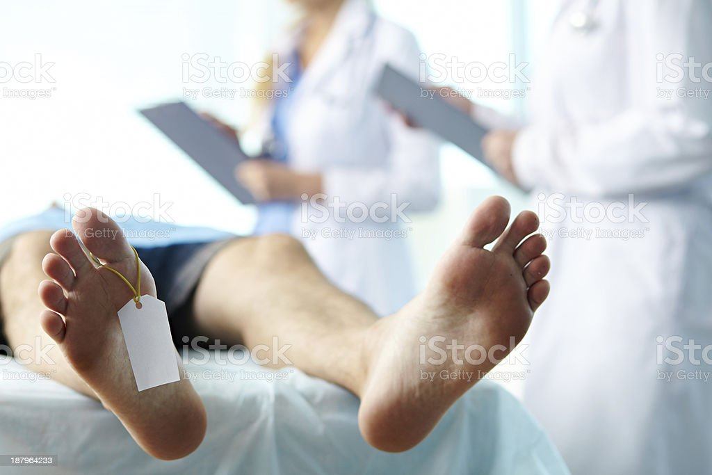 Body with toe tag stock photo