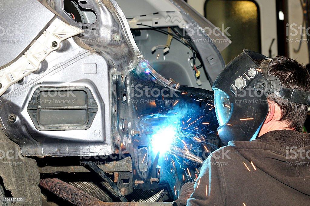 Body worker welding panels. stock photo